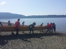 Lummi Youth Program setting out the canoes