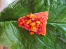 Trad foods- prepping salmon, salmonberries to wrap in swamp lantern leaves