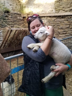 Holding a baby lamb