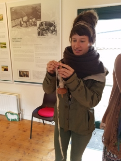 Woolen mill learning the drop spindle